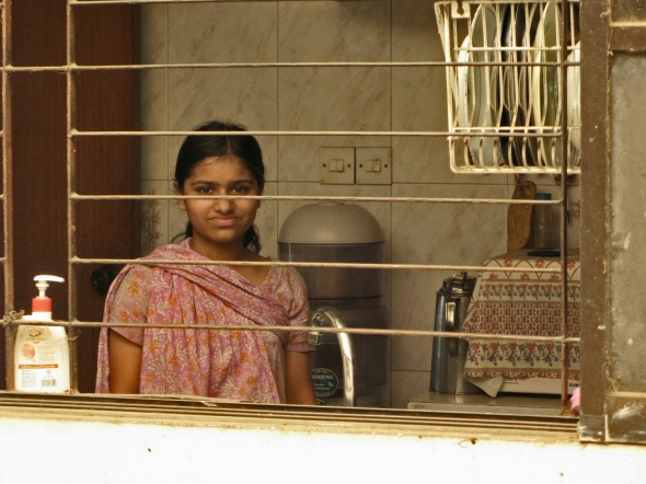 Unlike most Bangladeshis, the girl/sl e was reluctant to pose for our camera,