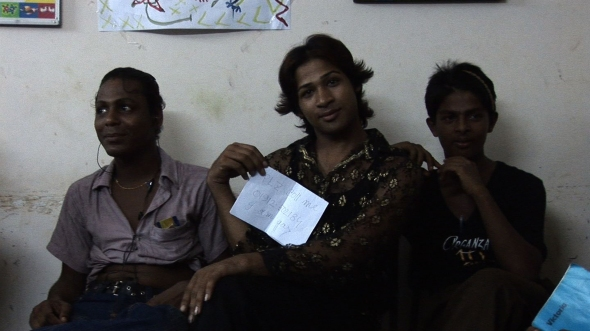 "Three Hijras from the class Seb and Aude taught. The paper reads: ""Plz coll me, I am gay"" with a phone number..."